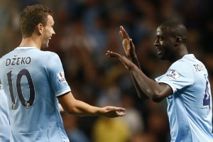 Manchester City's Toure celebrates his goal against Newcastle United with Dzeko during their English Premier League soccer match in Manchester